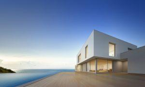 Modern White Beach House Architecture facing Ocean Bay